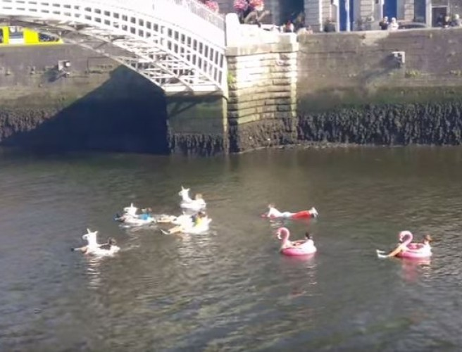 Fellas Float Down Liffey On Inflatable Unicorns