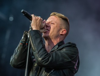 "Macklemore Denounces ""Racist"" Haircut"