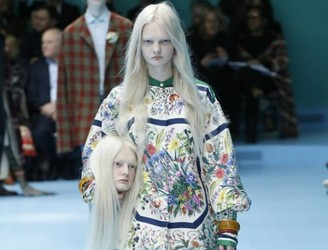 Heads Turn At Gucci Fashion Show