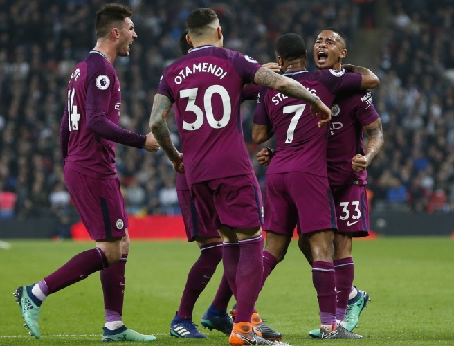 Players of Manchester City celebrate. Image: Han Yan/Xinhua News Agency/PA Images