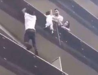 Man Rescues Child Dangling From Paris Balcony