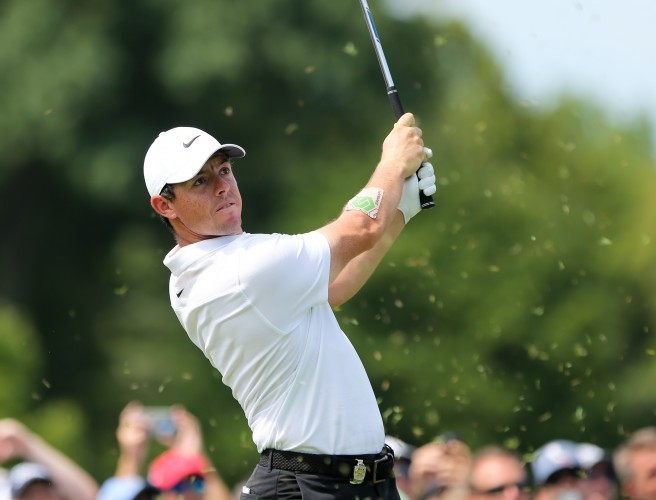 Rory McIlroy determined to play through the pain